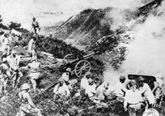 Japanese troops with their artillery pieces on the hills on HK Island Dec 1941.