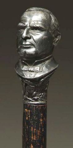 William H Harrison (Cane; Political,  Bust Knob, Protection, 1896, 32 inch. A political cane with cast pot metal handle in the likeness of William Harrison and marked PROTECTION, 1896;