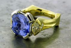 A William Travis Jewelry original. Amazing cushion cut blue sapphire with marquise and round brilliant diamonds accents. You'll never want to take it off. See more at williamtravisjewelry.com