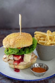 59 have made their best selling sandwich into a Burger & we can't wait to hear what you think of it. Chicken, bacon, brie and cranberry sandwiched between a corn top Devonshire Bakery bun & accompanied with fries. Cranberry Chicken, Gin Bar, Farm Shop, Chicken Bacon, Brie, Tasty Dishes, Lettuce, Sandwiches, Bakery