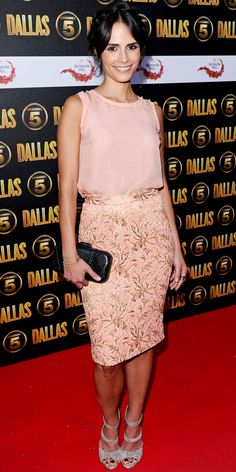 Brewster launched Dallas in London working a peach top and a brocade Dolce & Gabbana skirt. She accessorized with a black clutch and gray suede sandals.