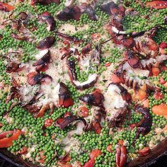 Smoky paella is perfect for a crowd. This recipe for six is designed for cooking on a charcoal grill—though a gas grill works in a pinch.