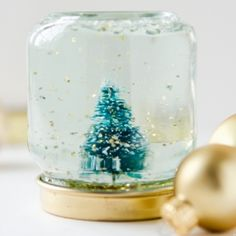 Turn old Baby Food Jars into mini Snow Globes! Fantastic handmade gift idea! Click for easy how-to's.