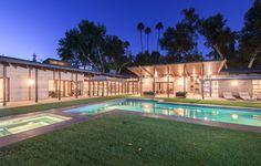 Modern concrete and glass pad set hillside above the San Fernando Valley