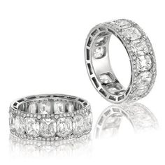 What a unique ring. Cushion cut diamonds are surrounded by a halo of pave. CACP_AACP <3CapriJewelers