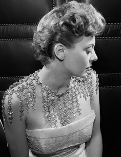 March 1950  The salon of Christian Dior has designed this pendant necklace that showers rhinestones over the shoulders, back and chest.