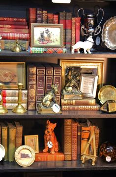 Monticello Antique Marketplace I love the age and the tones and the content of this bookshelf display.