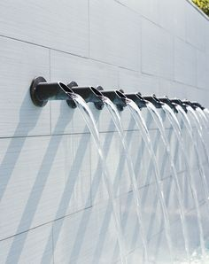 detail, multiple spouts on water feature wall, by Hocker Design