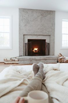 The Hidden Harmful Chemicals in Your Mattress & Why I Chose an Avocado Green Mattress – Lindsay concrete fireplace, cozy socks, winter fireplace Stucco Fireplace, Wooden Fireplace, Victorian Fireplace, Concrete Fireplace, Home Fireplace, Fireplace Remodel, Fireplace Design, Fireplace Ideas, Bedroom Fireplace