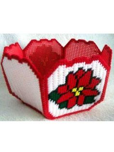 Poinsettia Basket Plastic Canvas Pattern Download from e-PatternsCentral.com -- Add flowers to your Christmas decor with this little poinsettia basket. It may be used to hold almost anything, or use it as a pot cover for your favorite plant.