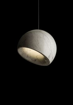 GEO Asymmetrical suspension lamp turned marble or onyx with high-performance LED lights. #LivingRoomFurniture, #ModernHomeDécor, #MarbleDécorIdeas