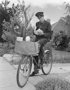 A postman of Postmaster General's Department in winter uniform on a suburban delivery run in Canberra, the National Capital of Australia, sorting through his mail, 1961. Learn more about Australia Post's history here: http://auspo.st/1C0gYkJ