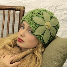 This hat is green, with a flower, it screams TINA. I'd like to learn how to knit.