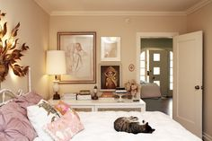 Apartment Therapy - bedrooms - tan, walls, pink, pillows, white, metal, bed, white, mirrored, dresser, pintuck shams, west elm shams,  Ethereal