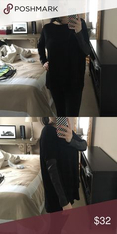Sexy Wyatt Black Faux leather arm oversized top Super sexy fashion comfy top with leggings! Excellent condition black with dark brown faux leather on arms. Love this style! No size tag, model is usually size small/ medium and it fit's big on her. I would say fits medium/ large wyatt Tops Tunics