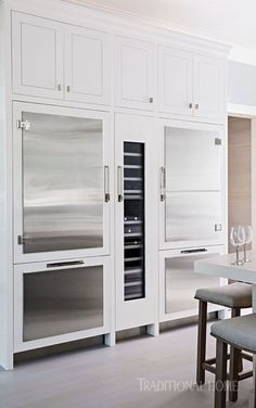 A glass-front Thermador wine refrigerator slips into the center of the cold-storage wall in this showhouse kitchen. - Photo: John Bessler / Design: Robert Bakes and Paul Kropp