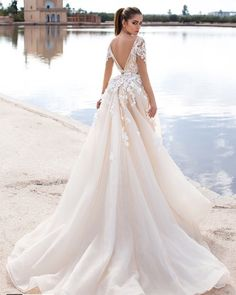 ddeea6bf696 The Lorenzo Rossi Bridal 2017 Collection is not only beautiful  Dazzling  styling that make these gowns a breath of fresh air.