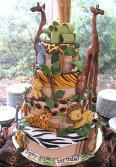 Jungle Cake: This was such a fun Jungle Cake to make! First, I baked and frosted a 6 cake, an 8 cake and a 10 cake and covered them in fondant. Then I added the