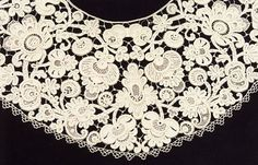 Inishmacsaint Lace is worked in fine linen thread. It is raised needlelace similar in method to the flat Youghal needlelace. The raised effect of Inishmacsaint is achieved by additional outlining sewn on to the lace after completion.