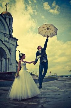 Terrific #wedding photo! Shades of famous Singing Butler painting of couple dancing on beach.