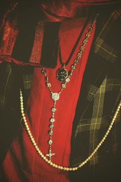 rosary, pearls and skull