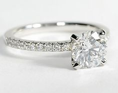 """Not really a big fan of solitaire engagement rings, but this one is kinda cute. The diamonds on the band """"bling"""" it up a bit! :)"""