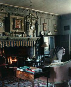 Restoration House ~ fretted Elizabethan oak chimney piece in Oak Saloon. Upholstered furniture dates from Charles II to George III.
