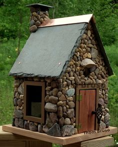 Thom Bruso makes the most amazing bird houses, like this River Stone House sided in stone and roofed in slate with a copper ridge. This one's been sold, but he's got plenty more extraordinary models for sale at his website thombruso.com. Or you can get inspired and create your own!