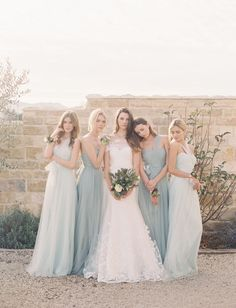 Love the colours of these mismatched bridesmaid dresses