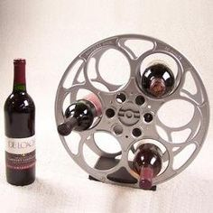 Home theater decor on pinterest home theater decor for Movie reel wine rack