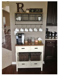 Cute coffee section! Love the baskets and the mugs on the rack! Love it all!
