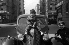 Stanley Kubrick with his sister Barbara Kubrick,  sitting on their father's car, in the Bronx, circa 1937