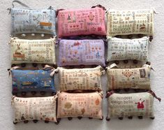 The 12 monthly Words Play from With thy Needle and Thread stitched on assorted colors of linen. Cross Stitch Sampler Patterns, Cross Stitch Samplers, Cross Stitching, Embroidery Patterns, Cross Stitch Collection, Cross Stitch Finishing, Small Pillows, Pincushions, Crafty Craft