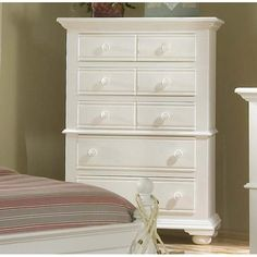 The Cottage Traditions Collection by American Woodcrafters is a gorgeous example of cottage style with simplicity in design mixed with elegance. This collection is made from solid pine with pine veneers and features solid wood hardware knobs in matching finish, bun feet, signature arched louvered inserts in the beds, mirrors and doors. Refine your bedroom space to stun you family and friends with your own style and detail.