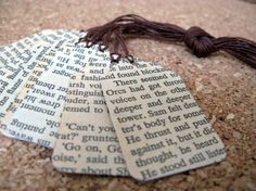 tag o' words  like i said. something like this for favors for a novel wedding using the pages  of novels.(you actually print vintage novel pages dyi)