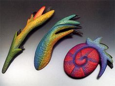 HELEN SHIRK - Orange Pistil, Blue-Green Frond, & Red Spiral (1996) brooches I THINK this is polymer...