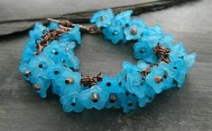 Turquoise flower and copper chain bracelet, Swarovski crystals and floral clasp Turquoise Flowers, Organza Gift Bags, Handmade Jewellery, Small Flowers, Seed Beads, Swarovski Crystals, Glass Beads, Copper, Jewelry Making