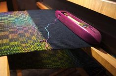 Piece on the loom with purple heartwood shuttle from bluster bay