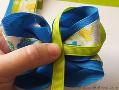 Learn how to make bows like the Twisted Boutique Bow, Pinwheel Bow, Spikes, and Surround Loops, and how to layer them all in our tutorial. Ribbon Bows, Ribbons, Diy Ribbon, Hair Bow Tutorial, Flower Tutorial, Disney Hair Bows, Ribbon Retreat, Rainbow Loom Charms, Pinwheel Bow