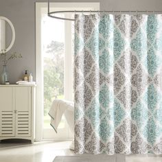 Spruce up your space with the Madison Park Claire shower curtain. This unique pattern has a small leaf print inside each diamond that makes up this crisscross design. Pops of dusty aqua give the perfect amount of color to add this collection into your neutral space.