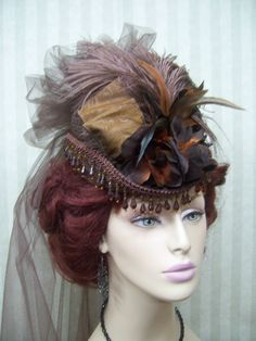 Brown lil gem topper hat with shades of brown embellishments