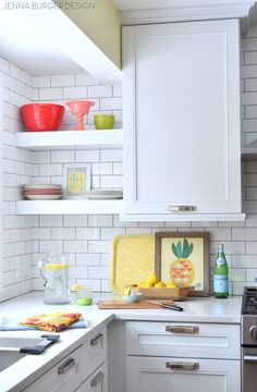 Check out this kitchen makeover reveal featuring white & gray cabinets, open shelving, subway tile backsplash, quartz countertops, and layers of color. Jenna Burger does it again!