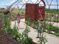 I like the idea shaped metal archway for plants to grow on.