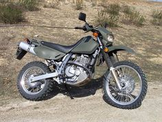 Suzuki DR 650 in olive drab. This would be perfect for tooling around the ADKs!