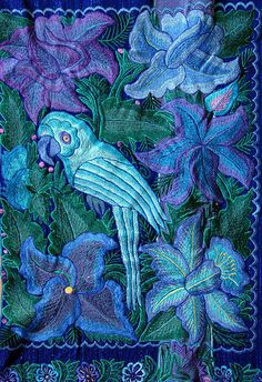 Blue Parrot Chiapas    This is a detail of the embroidery that decorated a Maya woman's cape made for the 2007 San Lorenzo fiesta in Zinacantan Chiapas Mexico