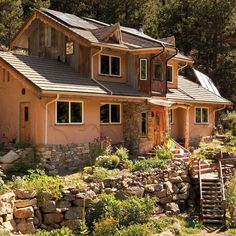 A Colorado couple delves into straw-bale building to create an artistic, nature-inspired dream home crafted from reclaimed building materials.