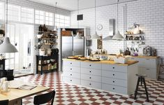 One of our favourite IKEA kitchens combining white tiles, a chequered floor and a classic  French bakery look.