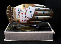 Golden Gesture with playing card motif by Volupte... One of the hardest of the Golden Gesture, Volupte Hand compacts.  With box and inside looking as well as outside,  $600 to $1000