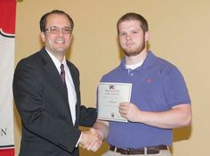 """Jordan Greene's """"Characterization of Cyanidin and Its Application in Solar Cells"""" won the Best Poster Award in the Sciences at the 2016 Undergraduate Research Symposium hosted by Valdosta State University."""