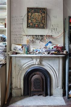 """""""The fireplace in Bourgeois' front sitting room. The telephone numbers on the wall are in her own hand (NICHOLAS CALCOTT)"""" via Inside artist Louise Bourgeois' New York home - Telegraph Louise Bourgeois, New York Homes, Installation Art, Decoration, Inspiration, Home Decor, Mantle, Fireplaces, Metal Sculptures"""